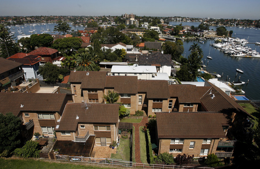 Apartment units and waterfront houses are seen on the harbour in Sydney © Mick Tsikas