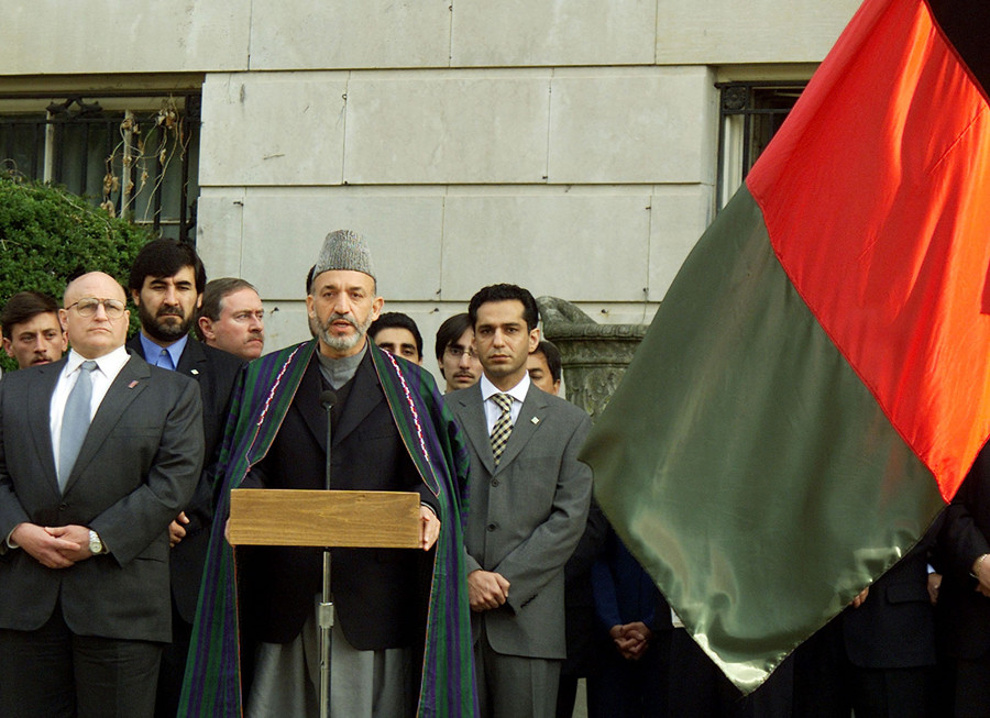 Afghanistan Interim Authority Chairman Hamid Karzai (2nd from R) speaks