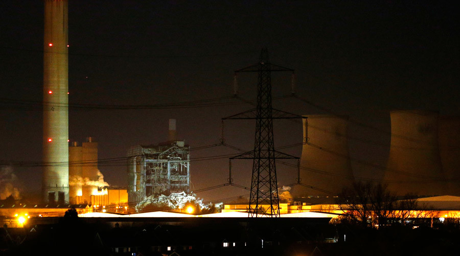 Part of a collapsed building is illuminated by the emergency services as they work at the decommissioned Didcot A power station in central England, February 23, 2016. © Peter Nicholls