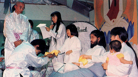 FILE PHOTO. Shoko Asahara, founder and leader of the Japanese-based sect, Aum Shinri Kyo, with its members. © Sputnik
