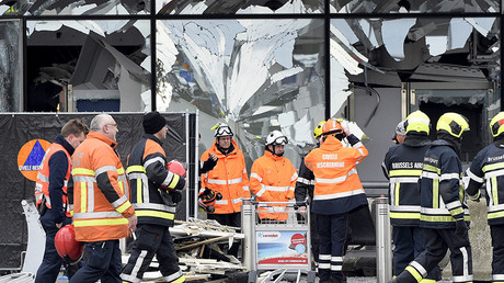 Broken windows of the terminal at Brussels airport are seen during a ceremony following bomb attacks in Brussels in Zaventem, Belgium, March 23, 2016. © Yorick Jansens