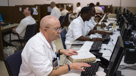 Offenders research and work on their papers inside the Southwestern Baptist Theological computer lab located in the Darrington Unit of the Texas Department of Criminal Justice men's prison in Rosharon, Texas © Adrees Latif
