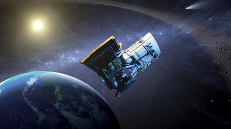 This artist's concept shows the Wide-field Infrared Survey Explorer, or WISE spacecraft, in its orbit around Earth. © NASA