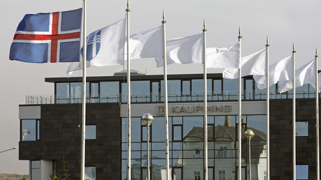 The Iceland flag flies next to the headquarters of Kaupthing Bank in Reykjavik © Bob Strong