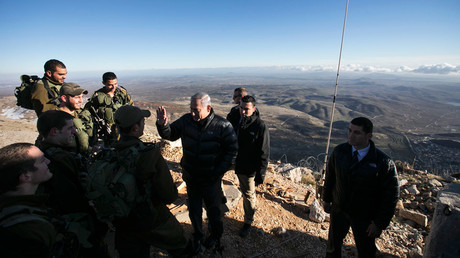 Israel's Prime Minister Benjamin Netanyahu (C) chats with Israeli soldiers at a military outpost during a visit to Mount Hermon in the Golan Heights over looking the Israel-Syria border February 4, 2015. © Baz Ratner