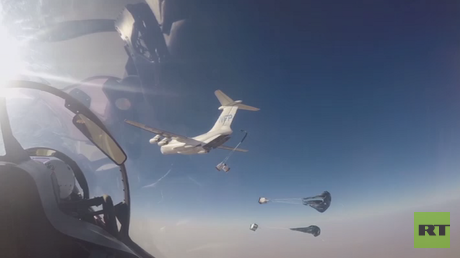 Russian Su-30 jets escort the UN World Food Programme aid delivery to the ISIS-besieged Syrian town of Deir Ezzor