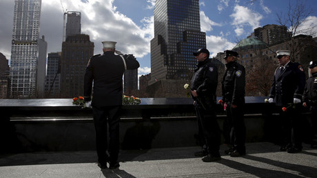A member of the FDNY salutes after laying a flower during a commemoration ceremony marking the 23rd anniversary of the 1993 World Trade Center bombing at the north reflecting pool of the 911 Memorial in New York © Shannon Stapleton