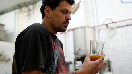 Itai Gutman, owner of Herzl Brewery, only has one bottle left. ©Ronen Zvulun