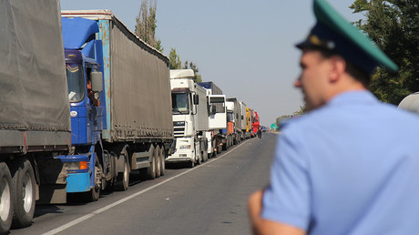 Heavy duty trucks standing in queue at the checkpoint