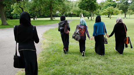 Students walk in the park near their school in Hackney, east London © Olivia Harris