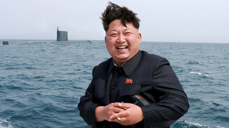 FILE PHOTO: North Korean leader Kim Jong Un watches the test-fire of a strategic submarine underwater ballistic missile © KCNA