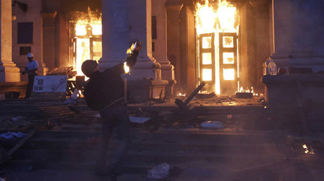 File photo: A protester throws a petrol bomb at the trade union building in Odessa May 2, 2014. © Volokin Yevgeny