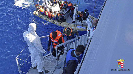 Migrants sit in a rescue boat during a rescue operation by Italian Navy vessels off the coast of Sicily in this April 11, 2016 handout picture provided by Marina Militare. © Marina Militare