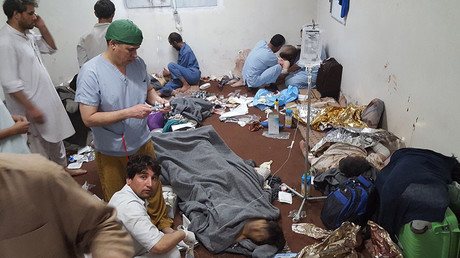 This handout photograph released by Medecins sans Frontieres on October 7, 2015, shows medical personnel as they treat wounded colleagues and patients in a hospital in Kunduz on October 3, 2015, in the aftermath of an airstrike on the facility in the northern Afghan city. © MSF