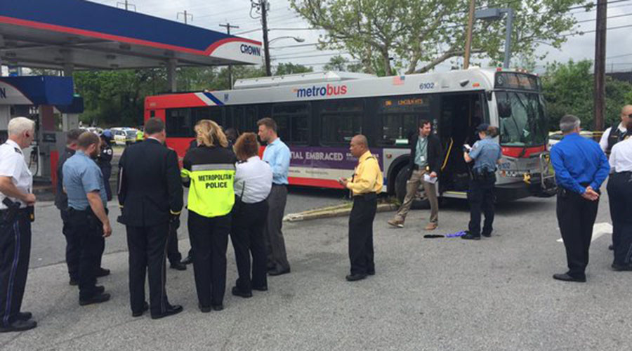 Pedestrian killed after man hijacks DC Metrobus, crashes it into gas station