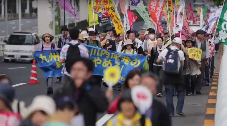 Mass protests in Japan as battle over changes to pacifist constitution looms