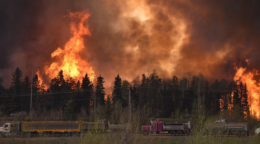 Engulfed by fire: Tens of thousands evacuating from Alberta blaze in Canada (PHOTOS, VIDEOS)