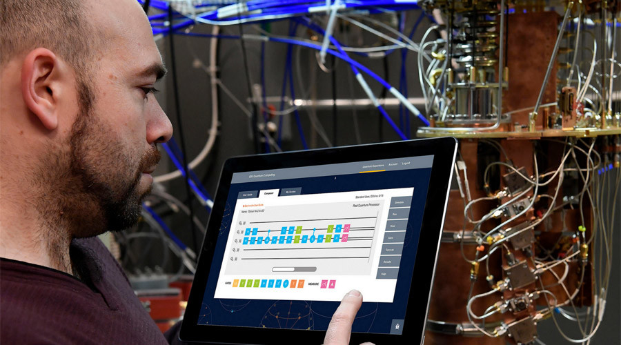 IBM Quantum Computing Research Scientist Antonio Corcoles uses the IBM Quantum Experience on a tablet in the IBM Quantum Lab that shows an open dilution refrigerator © Jon Simon, IBM Research ©