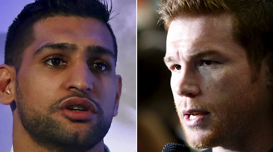 British boxer Amir Khan (L) and Middleweight boxing champion Canelo Alvarez. © Reuters