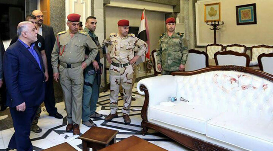 Iraqis rip into Prime Minister Abadi's reaction to stained white sofa following protest