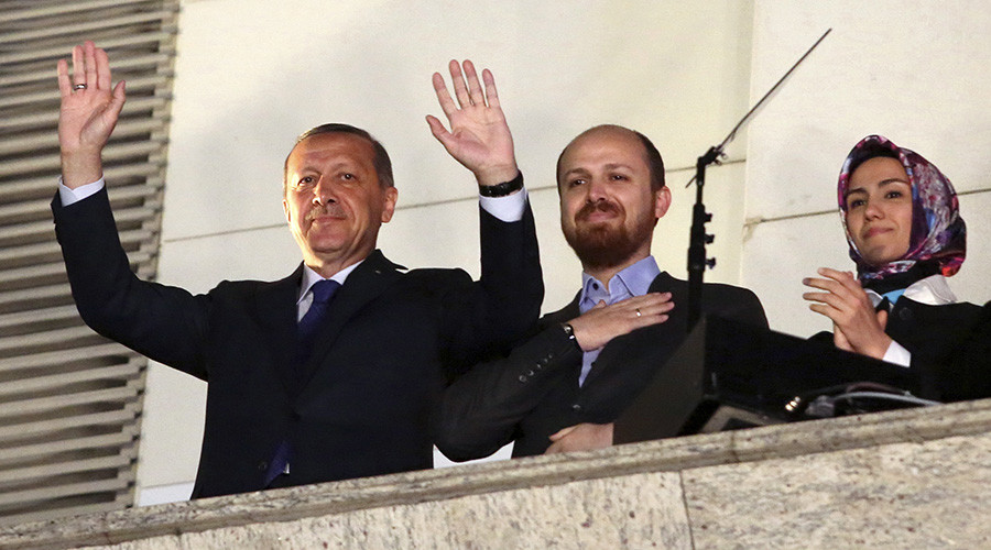 Turkish President Tayyip Erdogan (L), accompanied by his son Bilal and daughter Sumeyye, greets his supporters at the AK Party headquarters in Ankara © Stringer