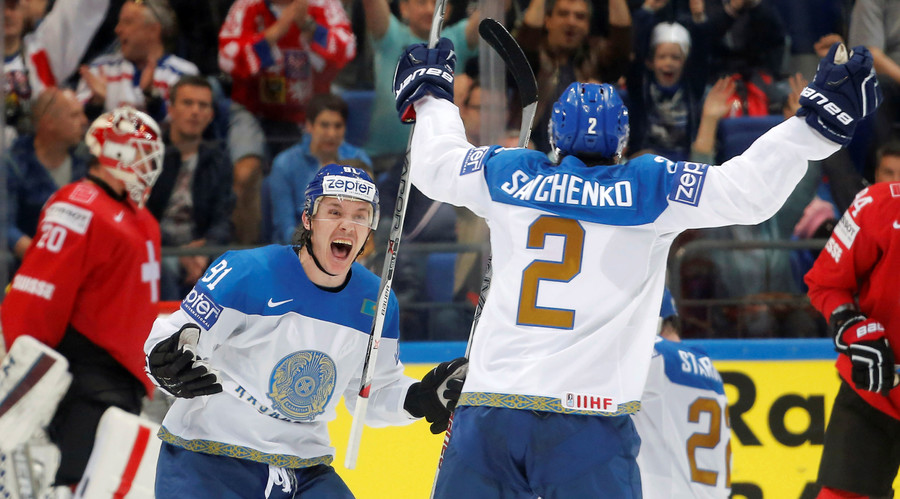 Kazakhstan's Nikita Ivanov and Roman Savchenko celebrate a score against Switzerland. © Maxim Shemetov