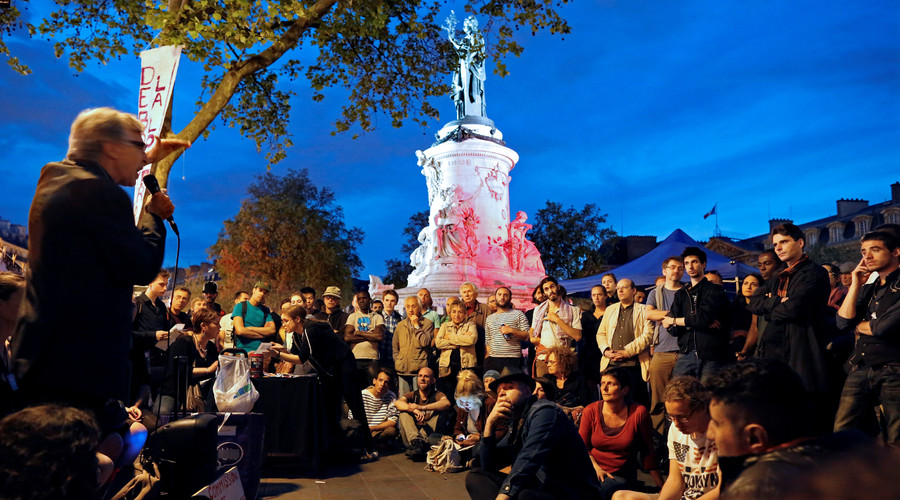 """Supporters of social media-driven movement """"Nuit Debout"""" (Up All Night), gather on the Place de la Republique in Paris, France, against a French labour law proposal, France, May 8, 2016. © Jacky Naegelen"""