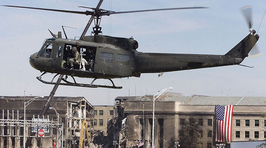 FILE PHOTO: A U.S. Army helicopter hovers before landing in front of the damaged area of the Pentagon Building September 17, 2001© Larry Downing