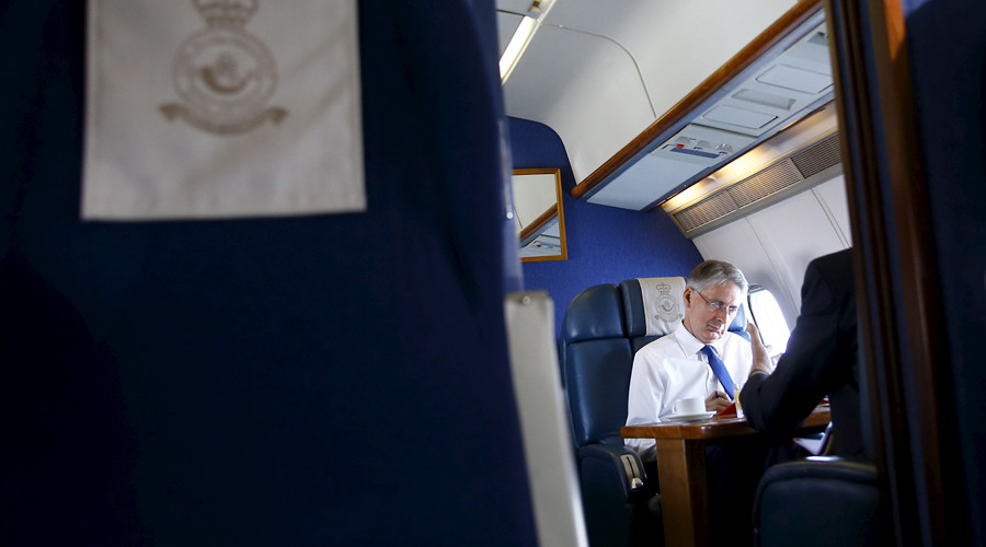 Britain's Foreign Secretary Philip Hammond works on a Royal Air Force airplane © Darren Staples
