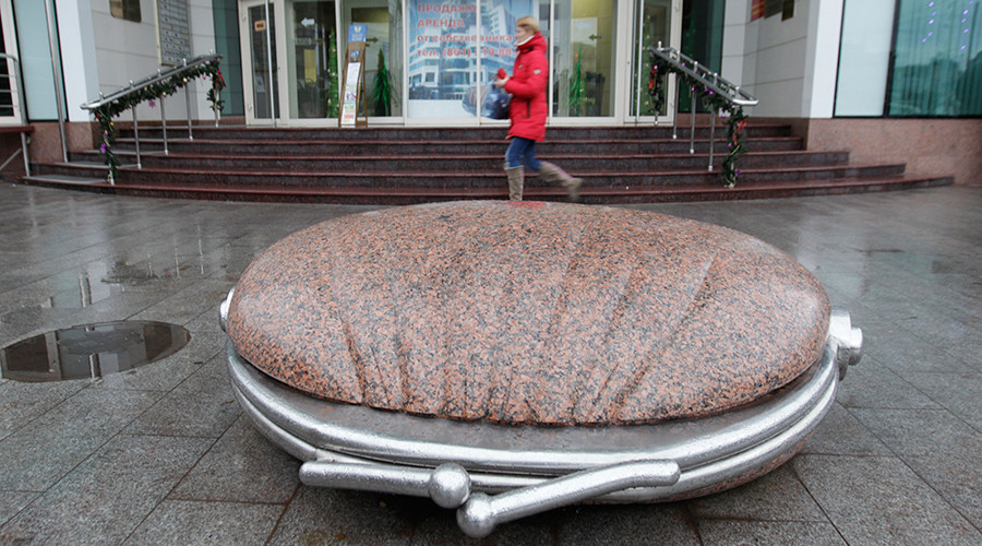 "A sculpture in the shape of a purse in front of ""Olympic Plaza"" business centre in the Russian southern city of Krasnodar © Eduard Korniyenko"