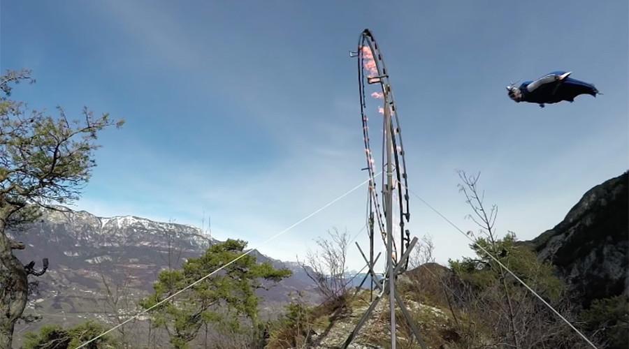 Wingsuit stuntman flies through ring of fire in unbelievable footage (VIDEO)
