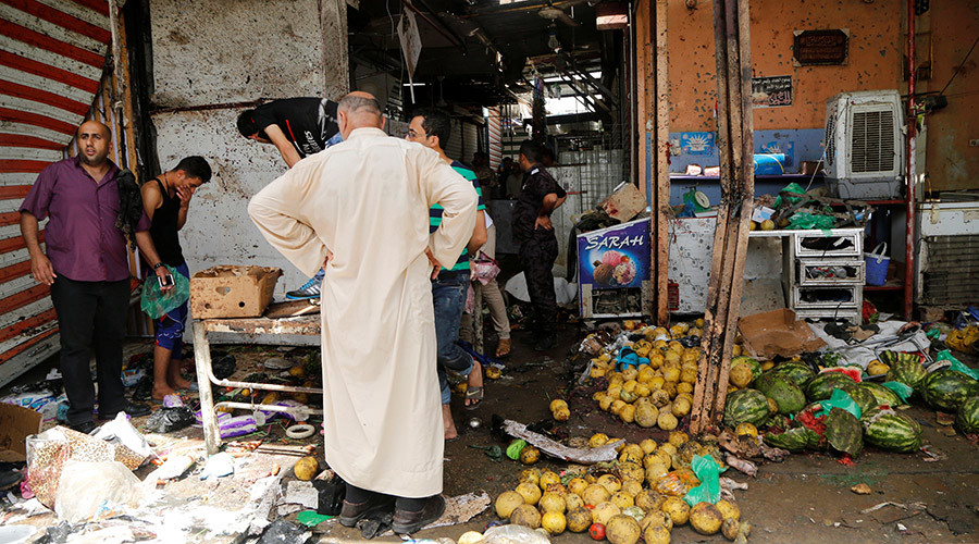People gather at the site of a suicide bomb attack in a marketplace in Baghdad's al-Shaab district, Iraqi May 17, 2016 © Wissm al-Okili