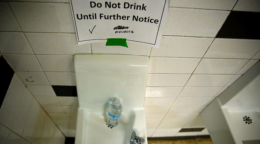 A sign is seen next to a water dispenser at North Western high school in Flint. © Carlos Barria