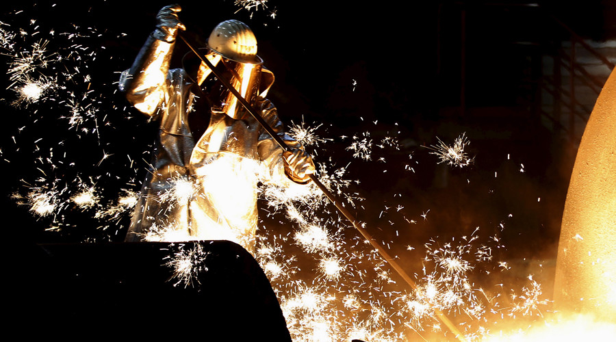 A worker controls a tapping of a blast furnace at steel factory © Ina Fassbender