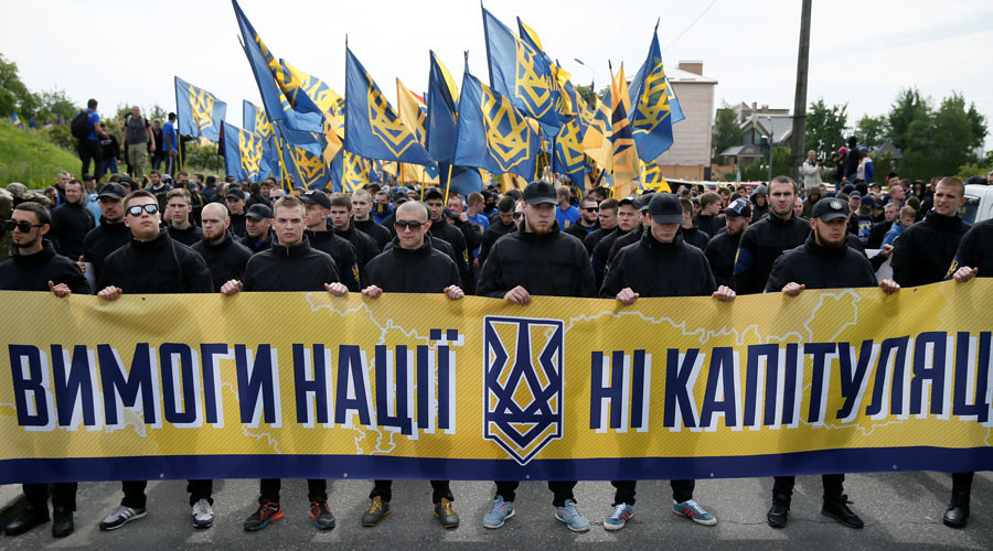 "Members of the Ukrainian interior ministry's ""Azov"" battalion hold a banner which reads ""Nation requirements - no surrender"" during a protest against local elections in eastern Ukraine under the Minsk peace agreement, in Kiev, Ukraine, May 20, 2016. © Gleb Garanich"