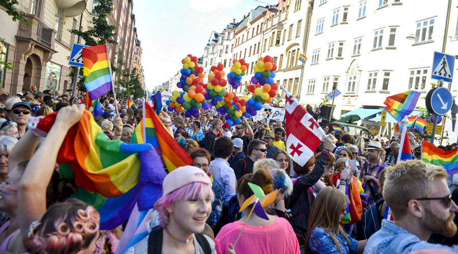 Participants attend the annual gay pride parade march in Stockholm, Sweden © Vilhelm Stokstad