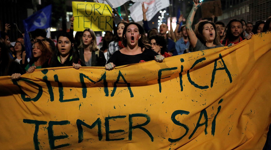 "Women shout slogans during a protest against Brazil's interim President Michel Temer and in support of suspended President Dilma Rousseff at Paulista Avenue in Sao Paulo, Brazil, May 17, 2016. The banner reads ""Dilma stays, Temer out"". © Nacho Doce"