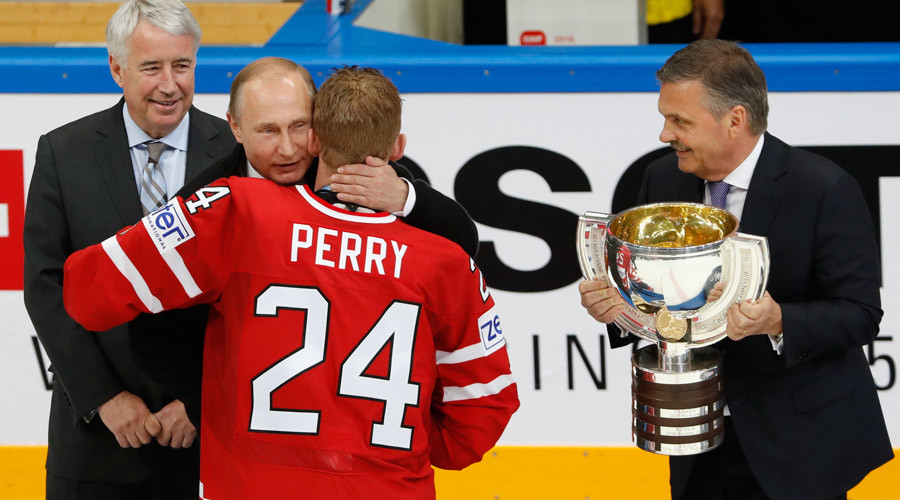 Russian President Vladimir Putin and head of the International Ice Hockey Federation (IIHF) Rene Fasel award Corey Perry of Canada during the victory ceremony after the final game. © Grigory Dukor