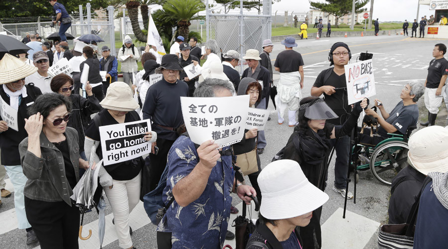 Okinawans protest murder by ex-Marine ahead of Obama's Japan visit