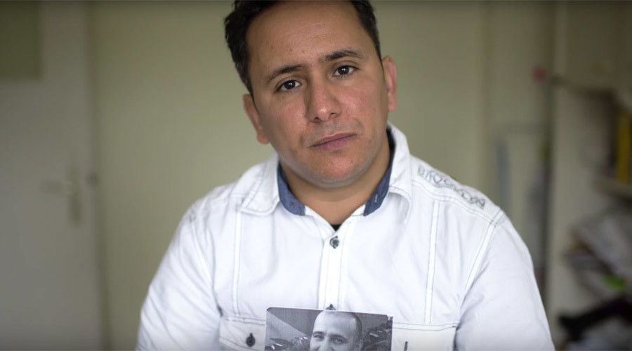 Yahdih Ould Slahi holds up a photo of his brother Mohamedou in a May 2016 video by American Civil Liberties Union © acluvideos