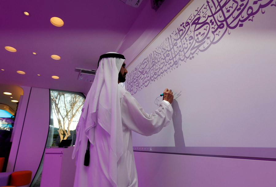 Sheikh Mohammed bin Rashid Al Maktoum, Vice-President and Prime Minister of the UAE and Ruler of Dubai, signs on the board during the official opening of the world's first functional 3D printed offices in Dubai May 23, 2016. © Ahmed Jadallah