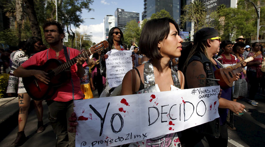 A woman takes part in a march against violence towards women in Mexico City, Mexico © Ginnette Riquelme