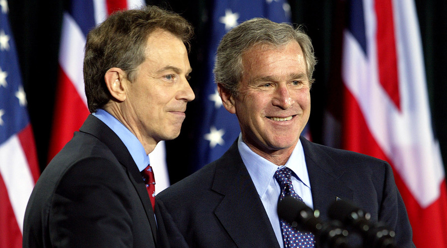 U.S. President George W. Bush and British Prime Minister Tony Blair (L). File photo. 2003. ©  Kevin Lamarque
