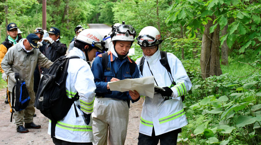 Search widened for Japanese boy missing in mountains abandoned by parents as punishment