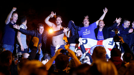 Leicester City fans celebrate their team winning the English Premier League outside the home of player Jamie Vardy in Melton Mowbray © Darren Staples