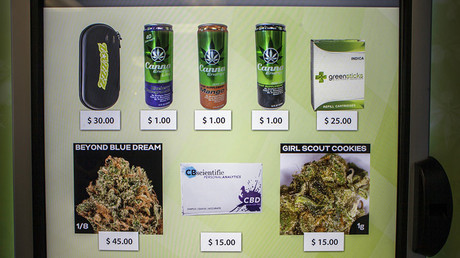 A view of the screen of a ZaZZZ vending machine that contains cannabis flower, hemp-oil energy drinks, and other merchandise at Seattle Caregivers, a medical marijuana dispensary. ©David Ryder