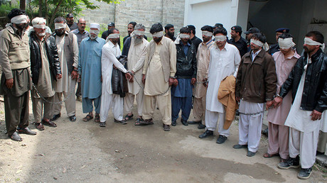 Members of a tribal council accused of ordering the burning death of a 16 year old girl are shown to the media after they were arrested by police in Donga Gali, outside Abbottabad, Pakistan May 5, 2016. © Online News