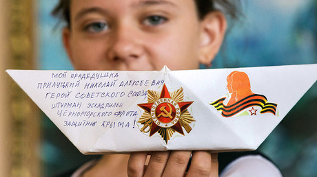 Paper ships, human statues & heart-shaped jet stunts: How Russians mark V-Day