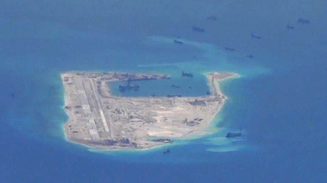 Chinese dredging vessels are purportedly seen in the waters around Fiery Cross Reef in the disputed Spratly Islands in the South China Sea in this still image from video taken by a P-8A Poseidon surveillance aircraft provided by the United States Navy May 21, 2015. ©U.S. Navy