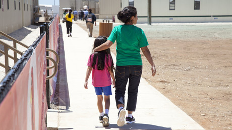 Residents walk through common campus area at the South Texas Family Residential Center, Dilley, Texas. © Charles Reed / U.S. Immigration and Customs Enforcement